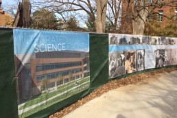 science banners hanging on construction fencing